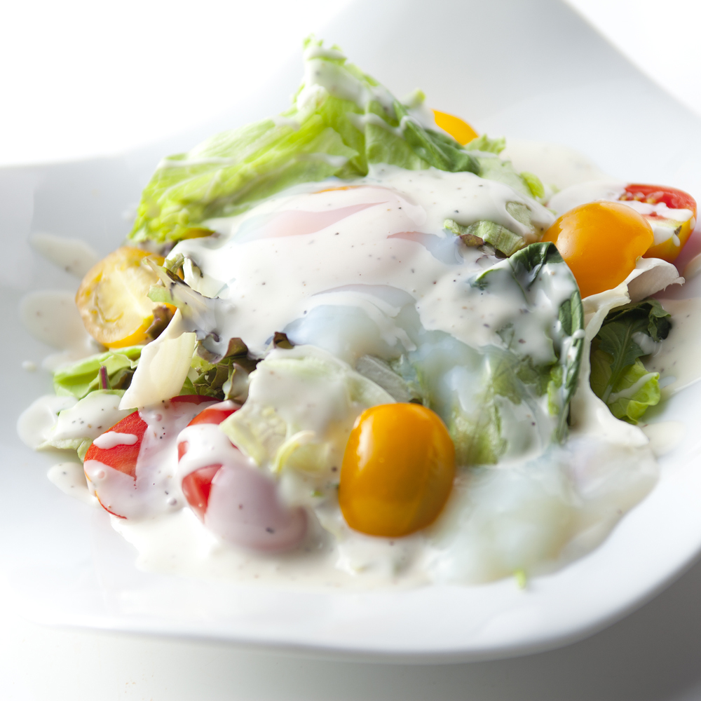 Caesar salad with Spanish-made ham and semisolid egg
