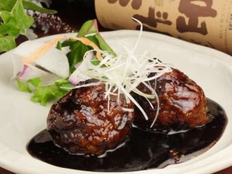 Black vinegar sweet and sour pork wrapped a lychee