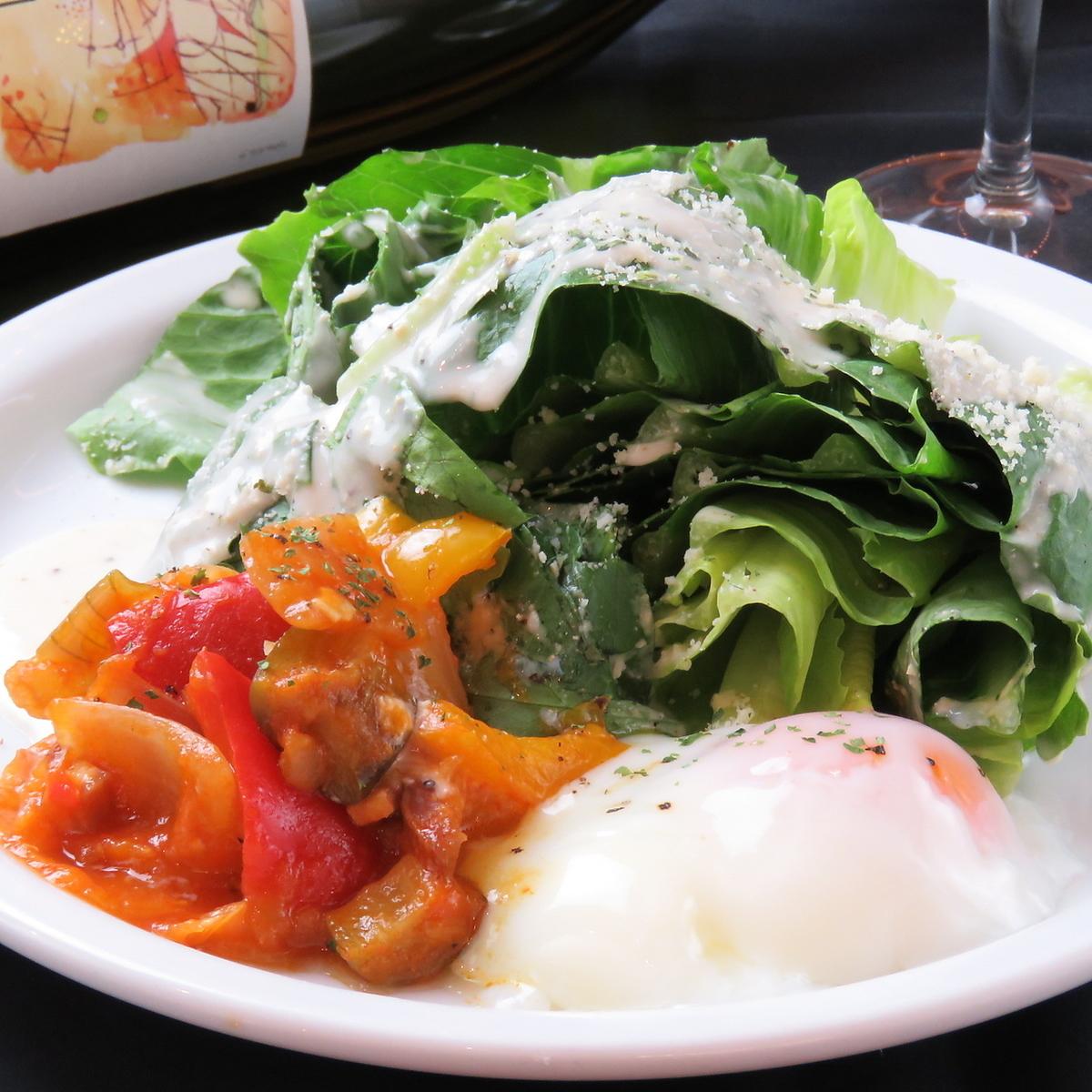 Romaine lettuce and Ratatouille caesar salad with warm balls