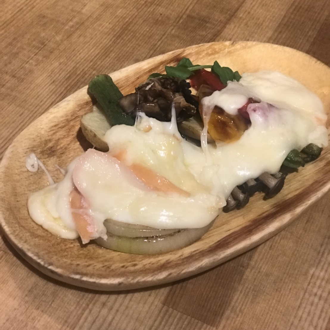 Grilled warm vegetables raclette cheese hang