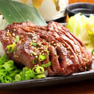 Specialty Extra thick cut beef tongue cooked fire