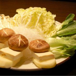 Tofu also contains vegetable platter (Chinese cabbage, bean sprouts, potatoes, tofu, enoki, shiitake)