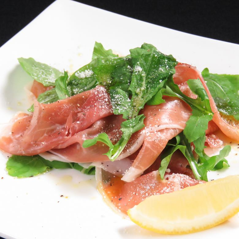 Raw ham and arugula