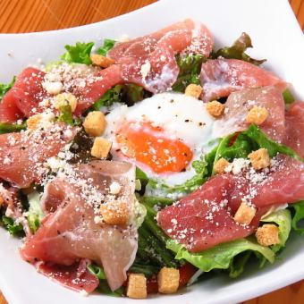 Soft-boiled egg and prosciutto Caesar salad