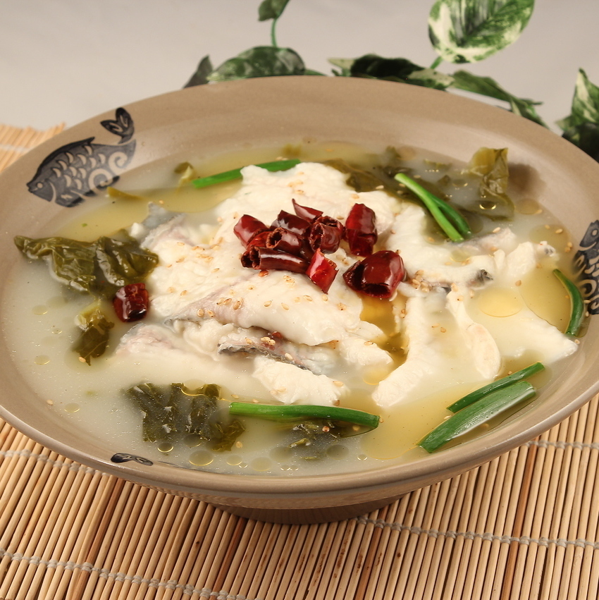 Spicy soup with white fish's canopy /
