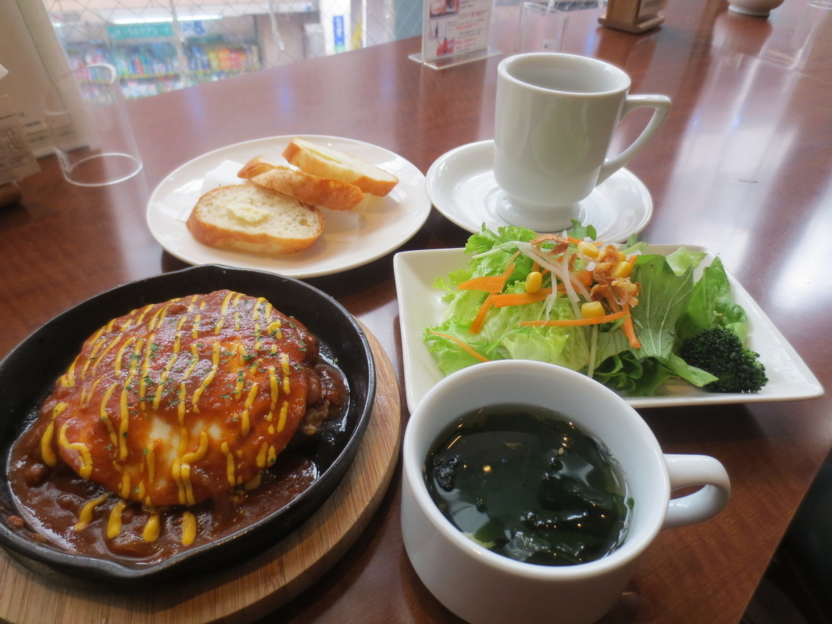 Her house hamburger steak (homemade hand sewn hamburger, homemade demiglas sauce used)