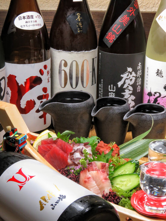 "Japanese sake throughout the country purchased from affiliated stores ""Sake Bars Gin Kura"""