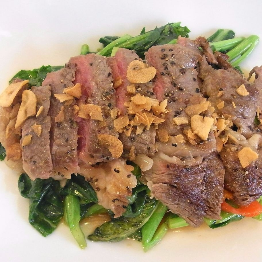 Stir-frying Thai green cooked beef steak with oyster sauce