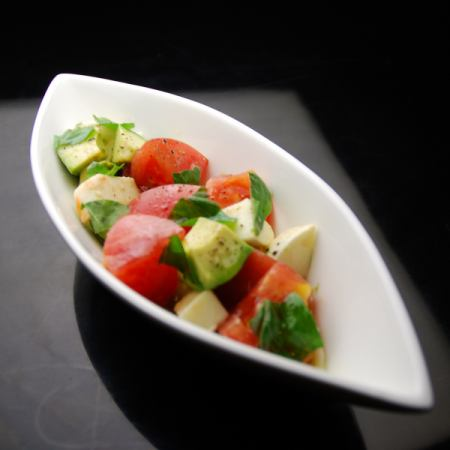 Caprese of tomato and mozzarella and avocado