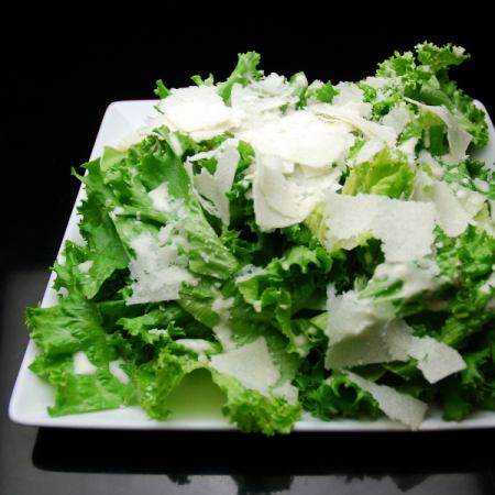 Salad of lettuce and plenty of Parmesan cheese