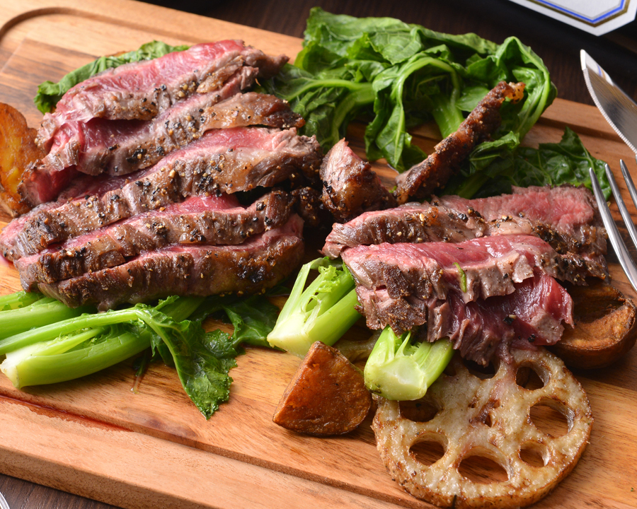 Charcoal grilling of beef sirloin and vegetables produced in Hokkaido