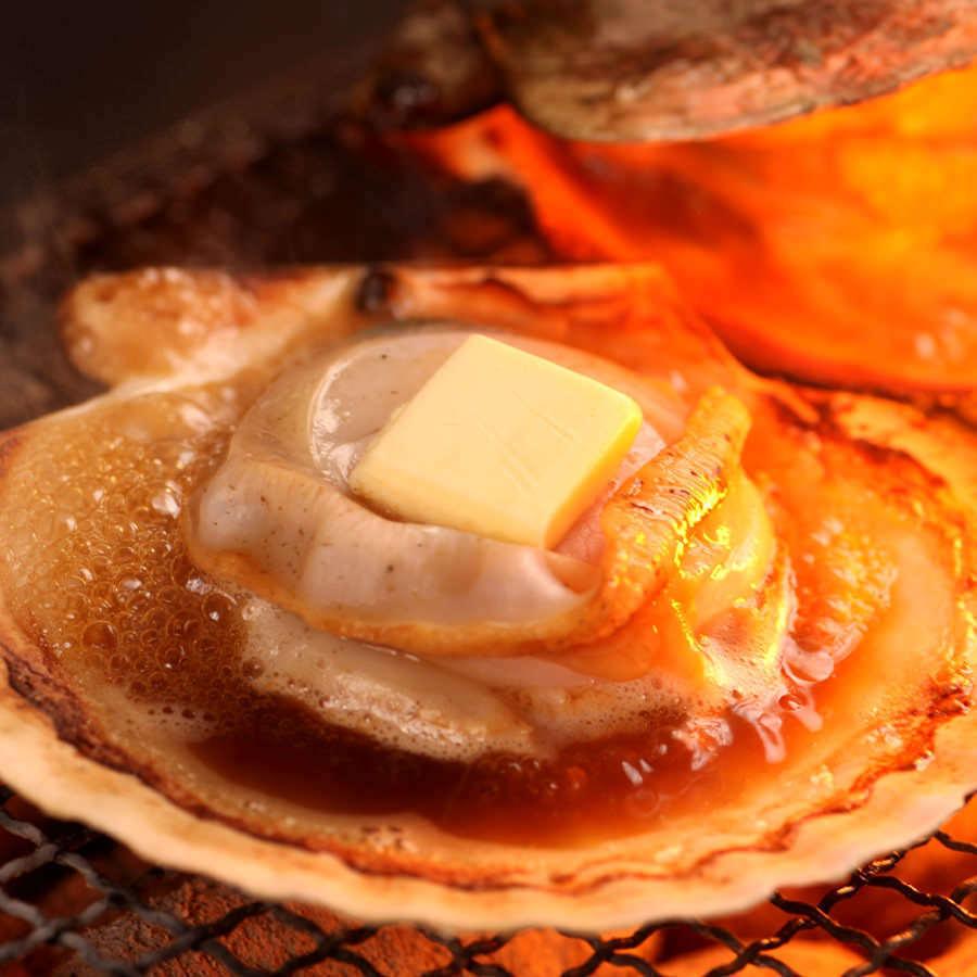 Scalloped butter on scallion ~ 2 scallops