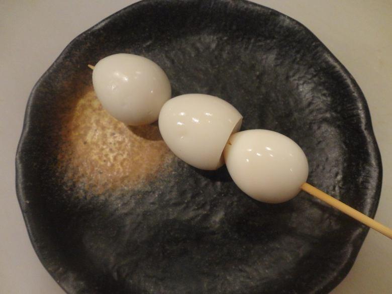 Quail egg with egg skewer
