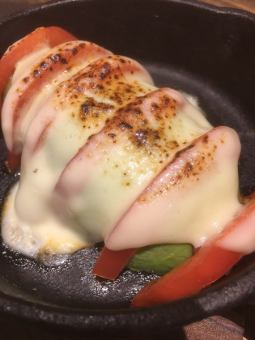 Grilled avocado and tomato with cheese
