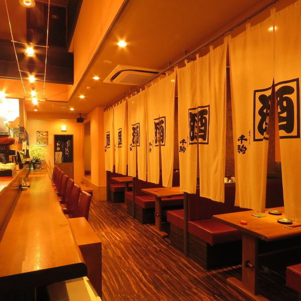 A Japanese-style space displaying souvenirs and alcoholic drinks.On the first floor there is a counter table · small raising.