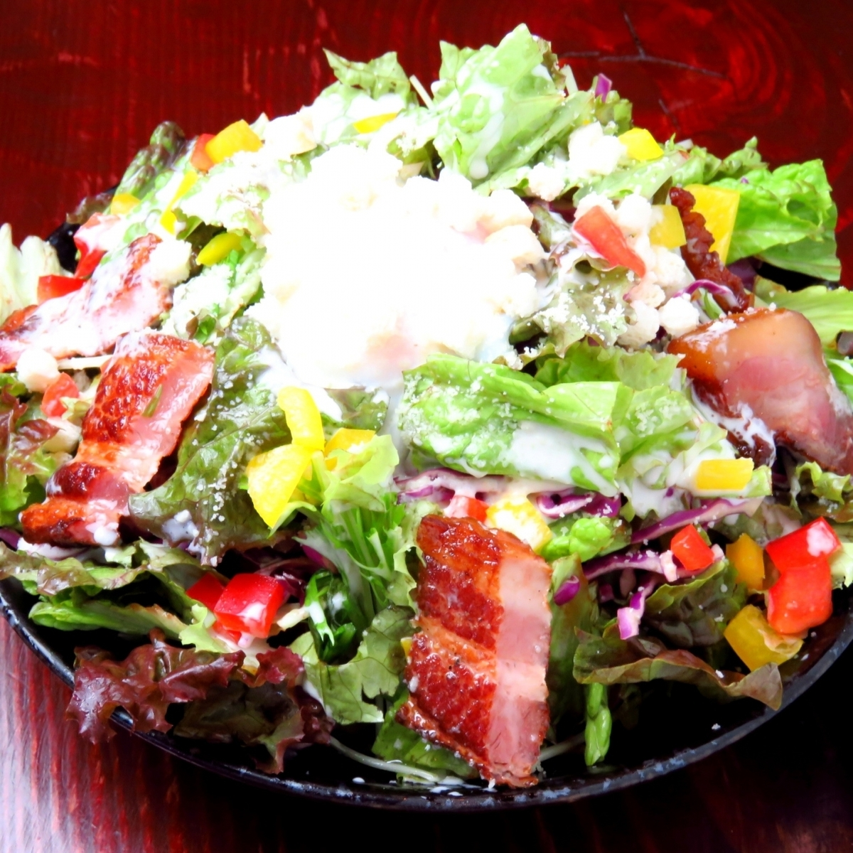 Broiled bacon and warm ball Caesar salad