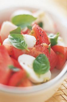 Caprese of ripe tomatoes and fresh mozzarella cheese