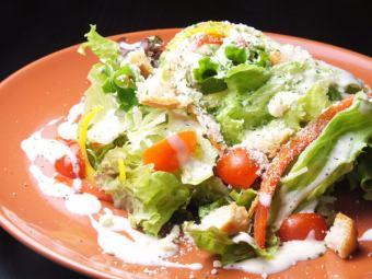 Homemade croutons and raw ham's Italian salad