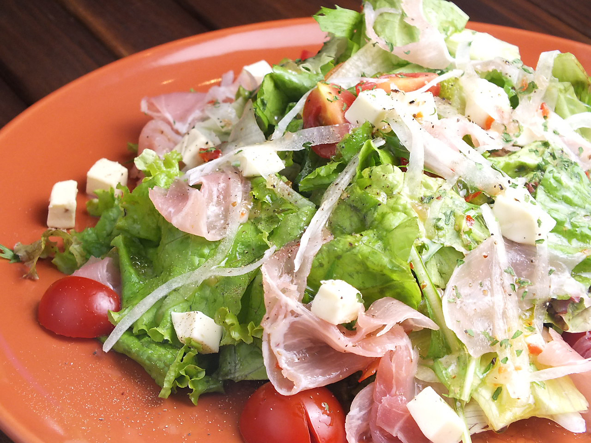 Italian salad with raw ham and cream cheese