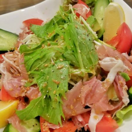 Salad with raw ham and ruggolo vegetables