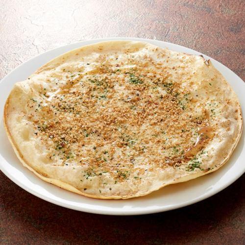ゴルゴンゾーラと金ゴマのハニーピザ