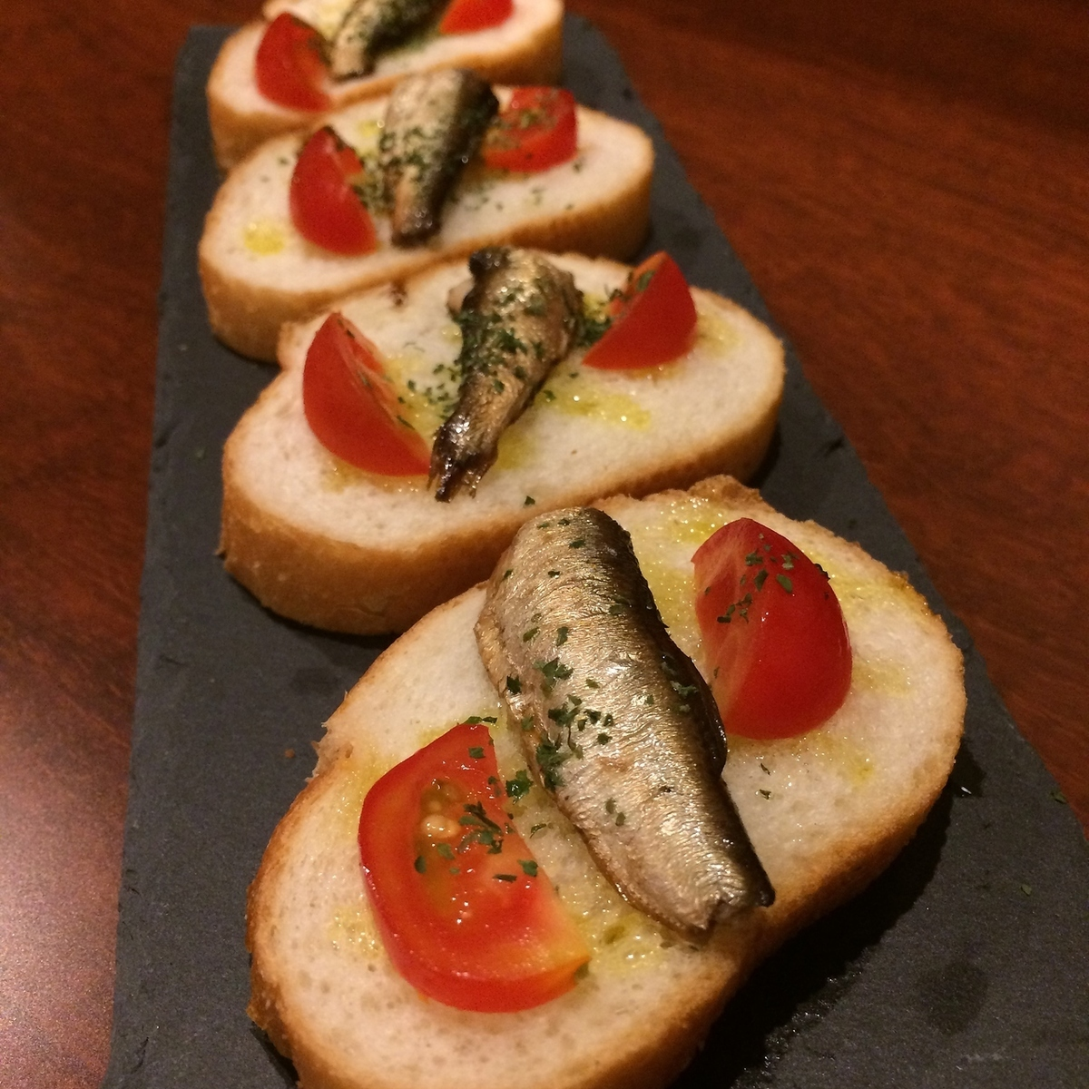 Smoked oil sardin's bruschetta