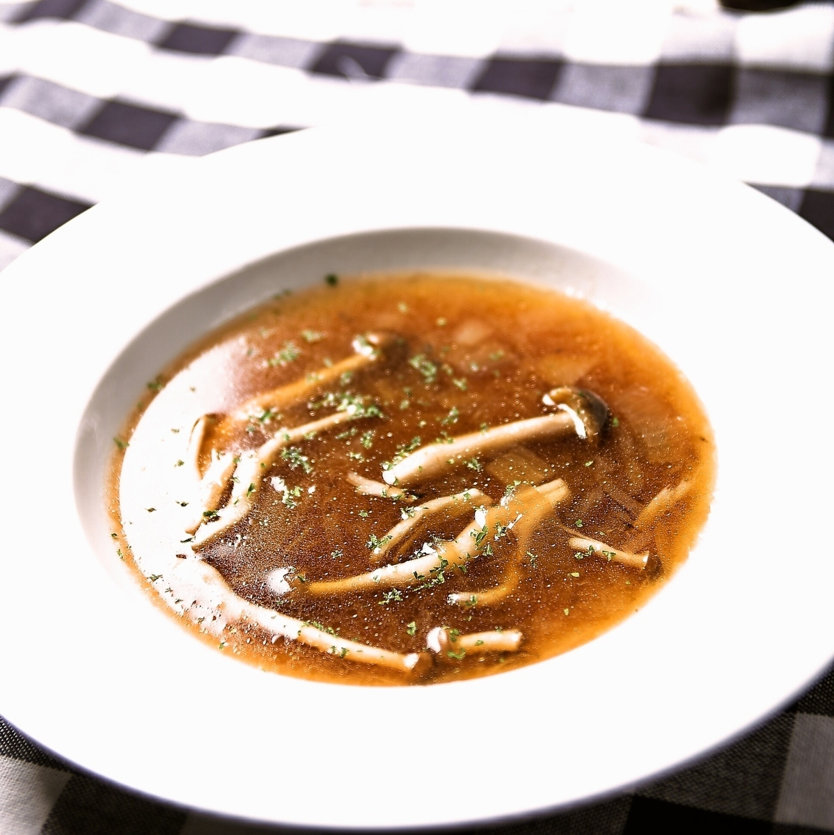 Vegetables and mashrooms soup with vegetable and wooden child's consomme soup