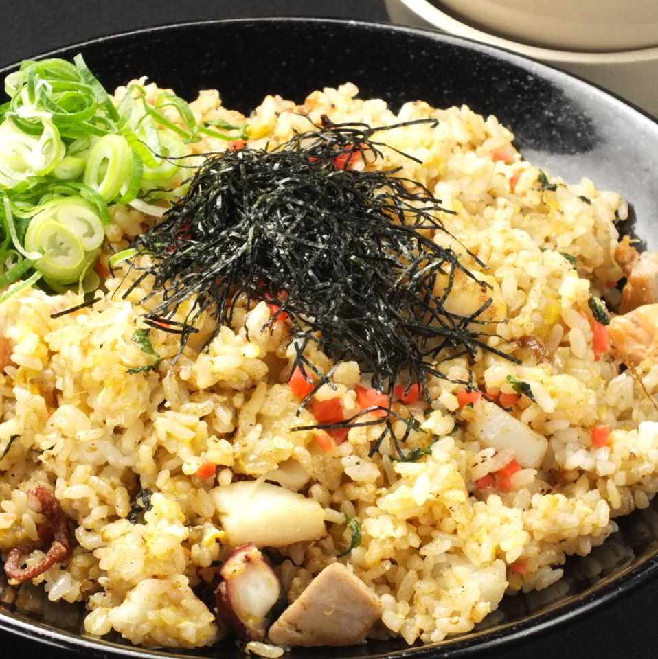 Japanese fried rice with seafood and large leaves